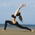 Yoga Teacher Training retreat - Extended Warrior on Beach