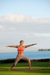 Yoga Teacher Demonstrating Warrior I